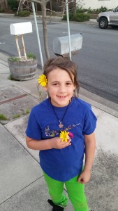 Pretty much every single Sunday we go on a family walk.  Keri's favorite thing to do is pick flowers along our walk.  Here she is sporting some of the flowers she picked.  So cute!