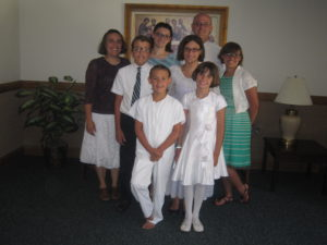 Our Family is growing up.  Jaime's baptism photo showed lots of little cherubs.  Now all my angles are growed up.